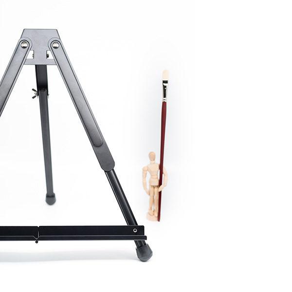 Black-Aluminium-Table-Easel-with-Manikin-holding-a-Paint-Brush