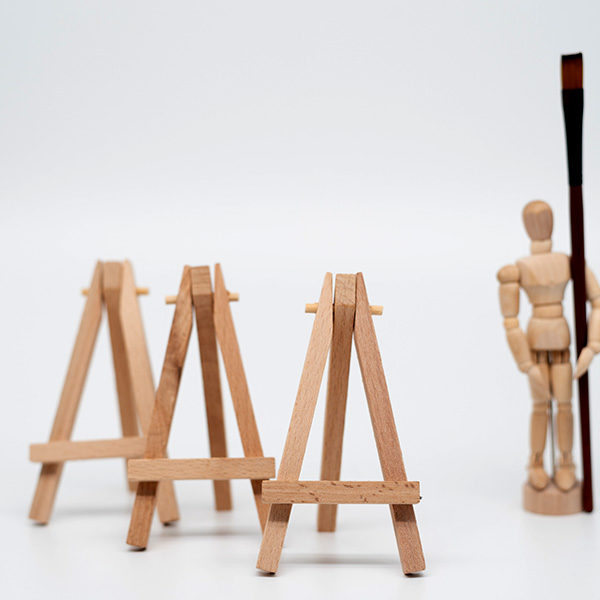 Prime-Art-3-Pocket-Easels-with-a-Manikin-Standing-next-to-them