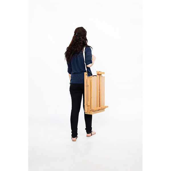 Wooden-French-Box-Style-Easel-Folded-being-carried-by-artist