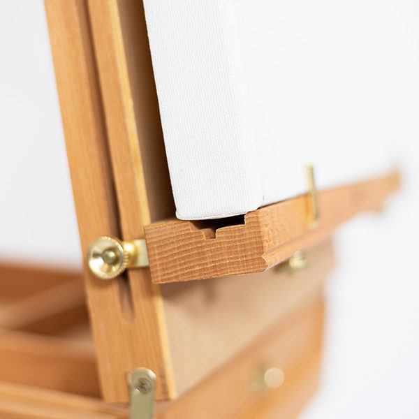 Wooden-French-Box-Style-Easel-ledge-with-canvas-on-it
