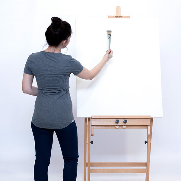 Model-Painting-on-a-Mont-Marte-Convertible-Studio-Easel-with-Canvas-on-the-Rack