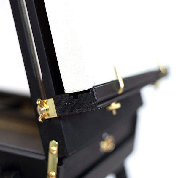 Mont-Marte-Black-French-Box-Easel-folded-open-side-view-with-canvas-on-it-close-up