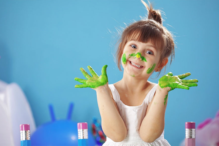 Small-Girl-with-Paint-on-her-hands-and-face
