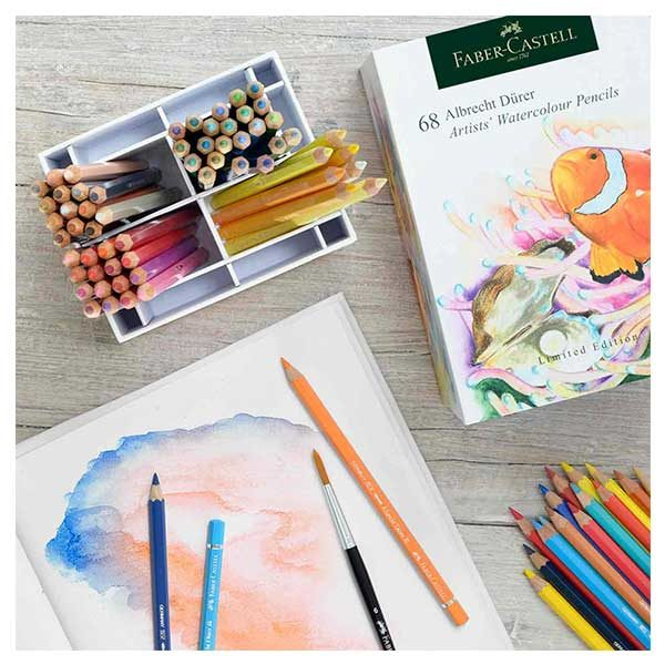 Faber-Castell-Albrecht-Durer-Watercolour-Pencils-Box-of-68-pencils-laid-out-with-a-book