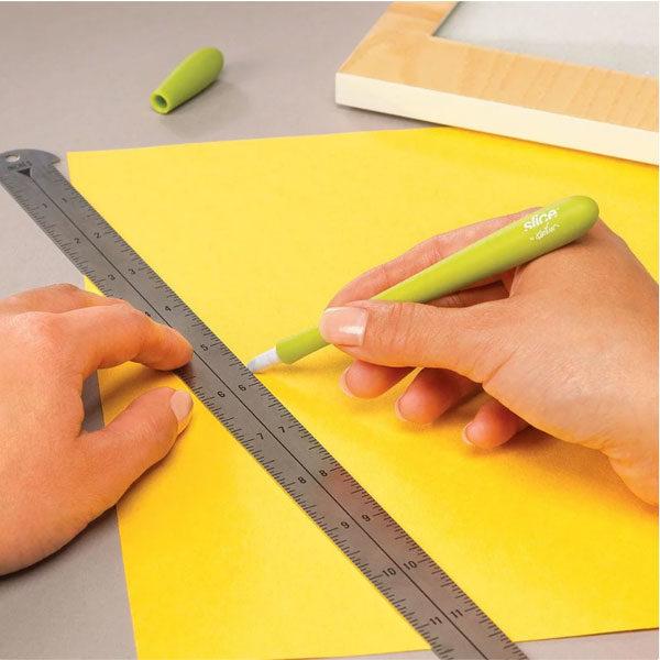 Slice-Precision-Cutter-cutting-through-paper-01