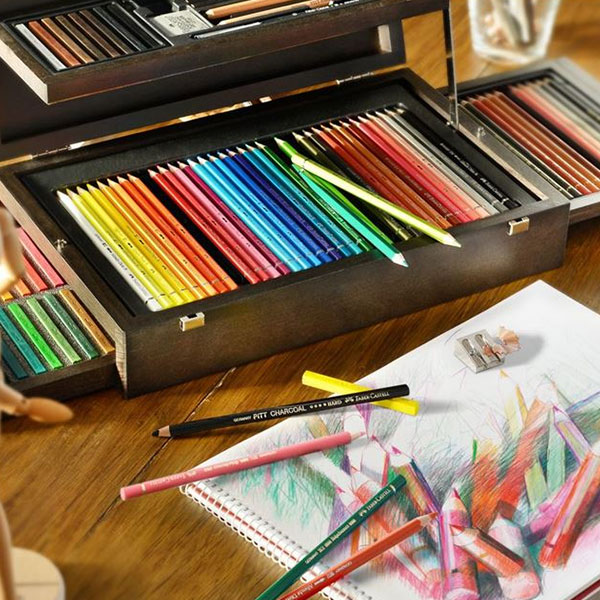 Faber-Castell-Art-&-Graphic-Collection-Wooden-Case-Set-with-sketch-pad-and-on-a-table