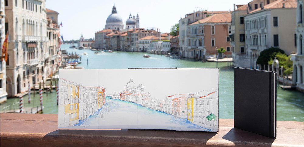 Fabriano-Leporello-Concertina-Journal-used-to-make-a-watercolour-painting-of-a-river-and-buildings
