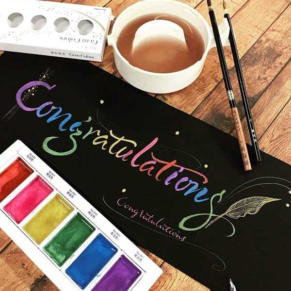 KURETAKE-GANSAI-TAMBI-Set-of-6-Gem-Colors-Sample-Paint-on-black-Paper